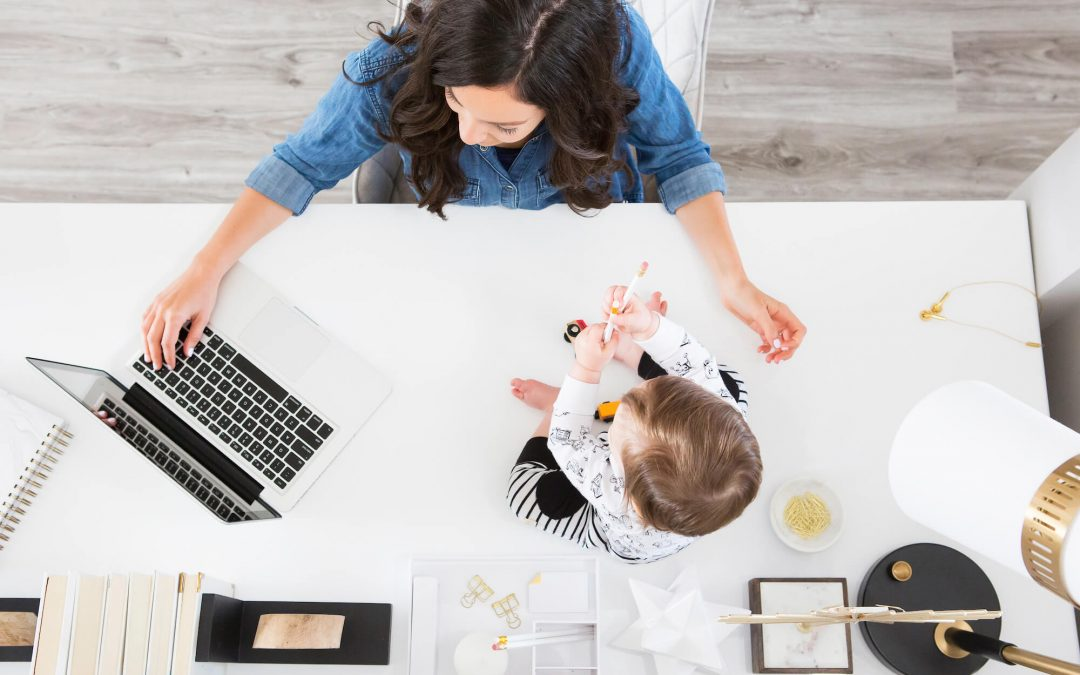 mom working at desk with a baby